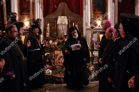 Patriarch of Antioch and All the East For Roman Catholics Gregory Iii Laham (c) Participates in a Candlelight Vigil Held at Al-zaytoun Chruch in Damascus Syria on 13 December 2011 in Support of Syrian President Bashar Assad and in Memory of Those who Were Killed During the Nine-month-old Crisis at Least 32 People Were Killed 13 December Among Them Army Defectors and Syrian Troops As Violence Intensified Between the Syrian Army and Defectors who Have Joined the Opposition Against President Bashar Al-assad Syrian Arab Republic Damascus