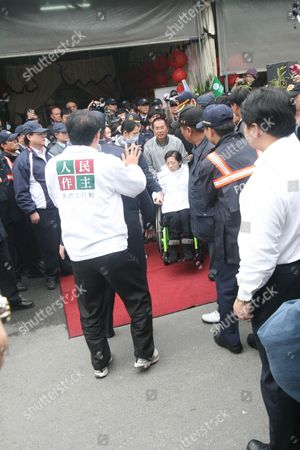 Taiwan's Ex-president Chen Shui-bian (c) Pushes His Wheelchair-bound Wife Wu Shen-chen From the Hsinying Funeral Parlour During His Mother-in-law's Funeral in Tainan Southern Taiwan 06 January 2012 Chen President From 2000-2008 and Serving a 17-and-a-half-year Jail Term For Corruption was Allowed to Pay Respected to His Deceased Mother-in-law on 06 January Chen Shui-bian Reiterated His Innocence in a Televised Speech During the Ceremony Reports State Taiwan Tainan