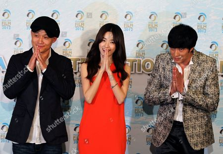 South Korean Director Song Il Gon (l) and South Korean Actors So Ji Sub (r) and Hun Hyo Joo (c) Greet in Thai Tradition During a Press Conference on Their Movie 'Always' at the Hua Hin International Film Festival 2012 in the Coastal City of Hua Hin Thailand 27 January 2012 the Film Festival Runs From 26 to 29 January Thailand Hua Hin