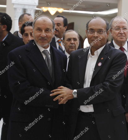 Stock Picture of Tunisian President Moncef Marzouki (r) Shakes Hands with Chairman of Libya's Ruling National Transitional Council (ntc) Mustafa Abdel Jalil Upon His Arrival in Tunis Tunisia 13 Janaury 2012 Abdeljalil is on Two-day Official Visit to Tunisia to Attend the Celebrations of the First Anniversary of Tunisia's Revolution Tunisians Will Mark on 14 Janaury 2012 the First Anniversary of the Fall of Dictator Zine El Abidine Ben Ali and Take Stock Following a Year of Mixed Blessings For the Country That Led the Arab World Down the Road of Revolution on January 14 2011 Ben Ali and His Wife Went Into Exile in Saudi Arabia After a Month of Protests Over His Corrupt Repressive 23-year Rule That Unleashed a Wave of Uprisings Across the Region Tunisia Tunis