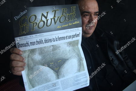 Tunisian Journalist and Human Rights Defender Taoufik Ben Brik Holds the First Edition of His New Weekly Newspaper 'Contre Le Pouvoir' (against the Power in French) As He Poses For a Photograph in Tunis Tunisia 18 February 2012 the Front Page of the Paper Shows a Nude Caricature Drawing According to Media Reports Reporters Without Borders (rsf) on the Same Day Called For the Release of the Tunisian 'Attounisia' Newspaper Publisher Nasreddine Ben Saida who is Being Held For Publishing a Photograph of a Nude Woman Under Charges of Assault on Public Morality the Photograph Featured German-tunisian Soccer Player Sami Khedira of Real Madrid with His Hands Covering the Breasts of His Naled German Model and Girlfriend Lena Gercke Tunisia Tunis