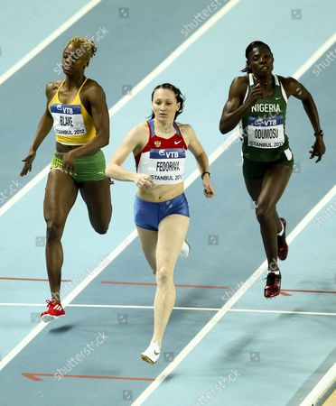 Stock Image of Aleksandra Fedoriva of Russia (c) Dominique Blake (l) of Jamaica and Muizat Ajoke Odumosu of Nigeria (r) Compete in the Women's 400m Heats at the Athletics World Indoor Championships at Atakoy Athletics Arena in Istanbul Turkey 09 March 2012 Turkey Istanbul