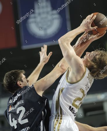 Stock Image of Real Madrid's Kyle Singler (r) Tries to Basket Under Defence of Anadolu Efes' Stanko Barac During Their Euroleague Group C Basketball Match at Sinan Erdem Arena in Istanbul Turkey 22 December 2011 Turkey Istanbul