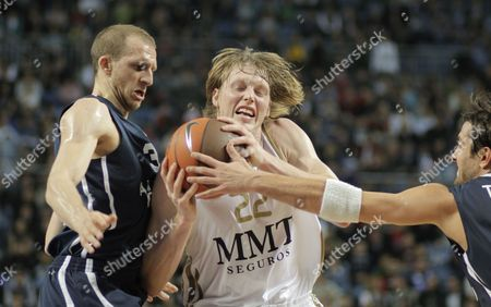 Stock Photo of Real Madrid's Kyle Singler (c) Challenges For Ball Against Anadolu Efes' Sinan Guler (l) and Kerem Tunceri During Their Euroleague Group C Basketball Match at Sinan Erdem Arena in Istanbul Turkey 22 December 2011 Turkey Istanbul