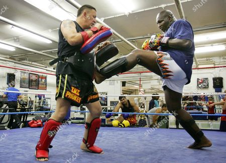 Stock Image of Mixed Martial Arts, training session, Peacock Gym, London - Julius Francis - Former Heavyweight Boxer (right), during a coaching session with Paul Marchant (trainer).
