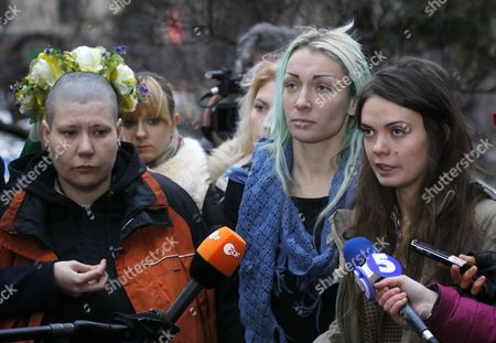 (l-r) Aleksandra Nemchinova Inna Shevchenko and Oksana Shachko Members of a Ukrainian-based Feminist Group Femen Speak with Journalists After Their Return in Kiev Ukraine 21 December 2011 They Were Arrested in the Belarusian Capital Minsk on Tuesday 19 December After Disrobing and Displaying Language Insulting to Belarusian President Aleksandr Lukashenko Written on Their Torsos the Demonstration Took Place in Front of the Headquarters of the Belarusian National Secret Police the Kgb Belarus' Belapan News Agency Reported Members of a Ukrainian Feminist Group Accused Belarusian Kgb (secret Police) of Abducting and Physically Abusing Them Because They Took Their Clothes Off in Public to Make a Political Point Belarusian Law Enforcement Officers Released the Three Ukrainian Women on Tuesday Evening in a Forest Near the City Gomel Some 300 Kilometres From Minsk After Making Physical Threats Against Them and Forcing Them to Undress Said Femen Member Aleksandra Shevchenko in a Twitter Comment Temperatures in the Region at the Time of Their Release on Tuesday Evening Were Approximately Zero Degrees Centigrade According to Recent Weather Reports Local Villagers Assisted the Ukrainian Women in Contacting Their Country's Embassy Which Sent a Worker to Escort Them Back to Ukraine the Ukrainian Interfax News Agency Reported Ukraine Kiev
