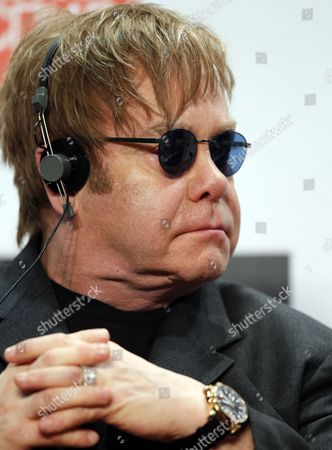 British Rock Singer-songwriter Elton John Attends Their Joint Press Conference with Elena Pinchuk (not in Picture) in Kiev Ukraine 09 November 2011 Founders of the Elton John Aids Foundation (ejaf) and the Elena Pinchuk Antiaids Foundation (efaaf) Presented to Journalists Their Second Joint Charitable Project Whose Goal is to Help Girls and Young Women who Are Spend Most of Their Lives on the Street and So Are Highly Vulnerable to Hiv to Gain Access to Hiv Testing and to Receive Vital Social Medical and Legal Assistance the Project is Implemented by the Global Health and Human Rights Organization Heaithright Intemational with the Generous Financial Support of the Eiton John Aids Foundation Which is Supported by the Elena Pinchuk Antiaids Foundation Estimates Place the Number of Children and Young People Living on the Streets of Ukraine Mostly Within Big Cities at Anywhere Between 20 000-100 000 Ukraine Kiev