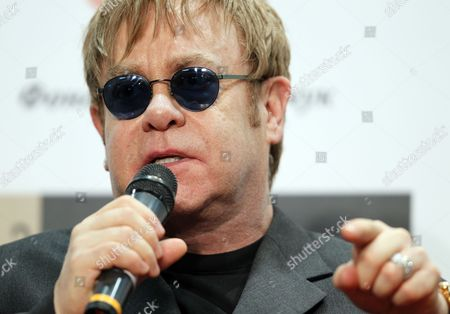 British Rock Singer-songwriter Elton John Attends Their Joint Press Conference with Elena Pinchuk (not Pictured) in Kiev Ukraine 09 November 2011 Founders of the Elton John Aids Foundation (ejaf) and the Elena Pinchuk Antiaids Foundation (efaaf) Presented to Journalists Their Second Joint Charitable Project Whose Goal is to Help Girls and Young Women who Are Spend Most of Their Lives on the Street and So Are Highly Vulnerable to Hiv to Gain Access to Hiv Testing and to Receive Vital Social Medical and Legal Assistance the Project is Implemented by the Global Health and Human Rights Organization Heaithright Intemational with the Generous Financial Support of the Eiton John Aids Foundation Which is Supported by the Elena Pinchuk Antiaids Foundation Estimates Place the Number of Children and Young People Living on the Streets of Ukraine Mostly Within Big Cities at Anywhere Between 20 000-100 000 Ukraine Kiev
