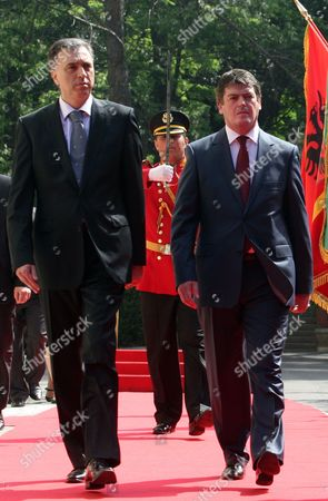 Montenegro President Filip Vujanovic (l) and His Albanian Counterpart Bamir Topi (r) Inspect an Honour Guard During the Welcoming Ceremony in Tirana Albania 03 May 2012 Vujanovic Arrives in Tirana For a Two-day Official Visit on an Invitation by His Albanian Counterpart Albania Tirana