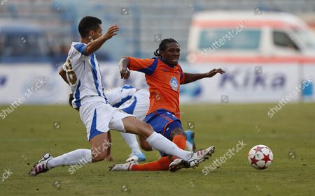 Elton Mucollari (l) of Kf Tirana Vies For the Ball with Jason Morrison of Aalesund Fk During Their Uefa Europa League Second Round Qualifying First Leg Soccer Match in Tirana Albania 19 July 2012 Albania Tirana