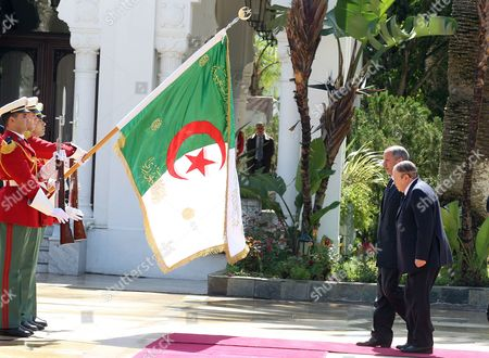 Algerian President Abdelaziz Bouteflika (r) and Chairman of Libya's National Transitional Council (ntc) Mustafa Abdul Jalil (2-r) Review a Guard of Honour Before Their Meeting at the Presidential Palace in Algiers Algeria 16 April 2012 Abdul Jalil is on His Second Day Official Visit in Algeria Algeria Algiers