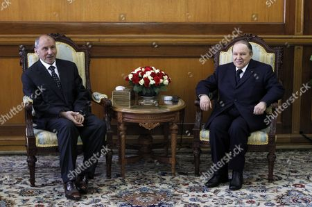 Algerian President Abdelaziz Bouteflika (r) and Chairman of Libya's National Transitional Council (ntc) Mustafa Abdul Jalil During Their Meeting at the Presidential Palace in Algiers Algeria 16 April 2012 Abdul Jalil is on His Second Day Official Visit in Algeria Algeria Algiers
