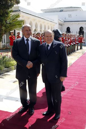 Algerian President Abdelaziz Bouteflika (r) Shake Hands with Chairman of Libya's National Transitional Council (ntc) Mustafa Abdul Jalil Before Their Meeting at the Presidential Palace in Algiers Algeria 16 April 2012 Abdul Jalil is on His Second Day Official Visit in Algeria Algeria Algiers