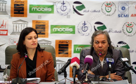 Stock Picture of Algerian Former Soccer Player and Unesco Goodwill Ambassador Rabah Madjer (r) with Unesco Representative Pilar Alvarez-laso (l) Give a Press Conference on 23 April 2012 in Algiers Algeria Ahead of a Football Charity Match For Children of Africa Between Former Algerian Football Stars and Former International Players This Evening in the Algerian Capital Algeria Alger
