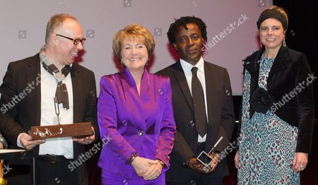 (l-r) British Museum Curator and Writer Charles Esche Princess Margriet of the Netherlands Ghana-born Filmmaker John Akomfrah and Princess Laurentien of the Netherlands Pose at the 4th Princess Margriet Award Ceremony in Brussels Belgium 19 March 2012 the Award was Initiated by the European Cultural Foundation (ecf) in Honour of the Organisation's Former President Princess Margriet This Year's Winners Are Ghana-born Filmmaker John Akomfrah and Museum Director and British Museum Curator and Writer Charles Esche Belgium Brussels