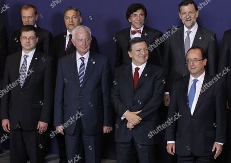 (l-r Front Row) Latvian Prime Minister Valdis Dombrovskis Greek Prime Minister Panagiotis Pikrammenos European Commission President Jose Manuel Barroso French President Francois Hollande with (l-r Back Row) Hungarian Prime Minister Viktor Orban Belgian Prime Minister Elio Di Rupo and Spanish Prime Minister Mariano Rajoy Take Their Positions For a Group Photo at the Informal Eu Summit in Brussels Belgium 23 May 2012 Eu Head of States Are Meeting in Brussels For an Informal Eu Summit on Economic Growth Which Marks French President Francois Hollande's Debut on the Eu Scene France is Expected to Push on the Issue of Eurobonds Which Has Put It at Loggerheads with Germany Belgium Brussels