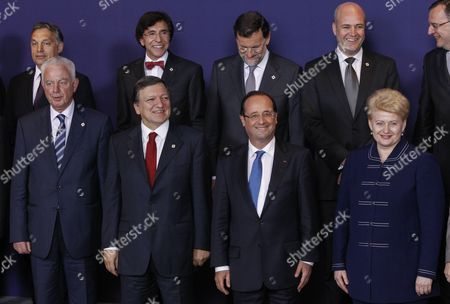 (l-r Front Row) Greek Prime Minister Panagiotis Pikrammenos European Commission President Jose Manuel Barroso French President Francois Hollande Lithuanian President Dalia Grybauskaite with (l-r Back Row) Hungarian Prime Minister Viktor Orban Belgian Prime Minister Elio Di Rupo and Spanish Prime Minister Mariano Rajoy Swedish Prime Minister Fredrik Reinfeldt and Czech Prime Minister Petr Necas Take Their Positions For a Group Photo at the Informal Eu Summit in Brussels Belgium 23 May 2012 Eu Head of States Are Meeting in Brussels For an Informal Eu Summit on Economic Growth Which Marks French President Francois Hollande's Debut on the Eu Scene France is Expected to Push on the Issue of Eurobonds Which Has Put It at Loggerheads with Germany Belgium Brussels