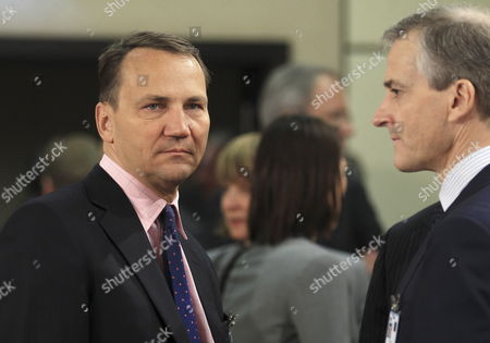 Polish Foreign Minister Radoslaw Sikorski (l) and Norwegian Minister of Foreign Affairs Jonas Gahr Stoere (r) at the Start of a Nato - Russia Foreign Ministers Council Meeting at the Alliance Headquarters in Brussels Belgium 19 April 2012 Belgium Brussels