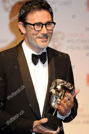 French Director Michel Hazanavicius Poses on Behalf of Guillaume Schiffman After Winning the Cinematography Award For His Movie 'The Artist' During the Baftas Orange British Academy Film Awards in London Britain 12 February 2012 United Kingdom London