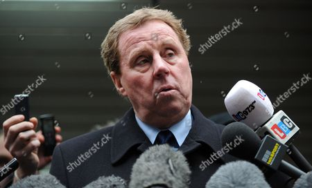 Tottenham Hotspur Manager Harry Redknapp (r) Speaks to Reporters Outside the Southwark Crown Court After His Tax Evasion Trial in London Britain 08 February 2012 Tottenham Manager Harry Redknapp was on 08 February Cleared of a Tax Evasion Charge After a Trial in London Lasting More Than Two Weeks Redknapp who Has Been Tipped As Next England Manager Had Denied Accepting Secret Untaxed Bonus Payments From Former Portsmouth Chairman Milan Mandaric While He was That Clubs Manager After the Verdict Redknapp Embraced Mandaric who was Also Cleared of Two Charges of Tax Evasion Redknapp was Accused of Cheating the Public Revenue in Relation to Payments Totalling 189 000 Pounds (about 300 000 Dollars) Made to His Bank Account in Monaco United Kingdom London