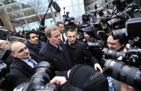 Tottenham Hotspur Manager Harry Redknapp (c) Departs Southwark Crown Court Following His Tax Evasion Trial in London Britain 08 February 2012 Tottenham Manager Harry Redknapp was on 08 February Cleared of a Tax Evasion Charge After a Trial in London Lasting More Than Two Weeks Redknapp who Has Been Tipped As Next England Manager Had Denied Accepting Secret Untaxed Bonus Payments From Former Portsmouth Chairman Milan Mandaric While He was That Clubs Manager After the Verdict Redknapp Embraced Mandaric who was Also Cleared of Two Charges of Tax Evasion Redknapp was Accused of Cheating the Public Revenue in Relation to Payments Totalling 189 000 Pounds (about 300 000 Dollars) Made to His Bank Account in Monaco United Kingdom London
