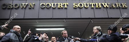 Tottenham Hotspur Manager Harry Redknapp (c) Makes a Statement to the Press Outside Southwark Crown Court Following His Tax Evasion Trial in London Britain 08 February 2012 Tottenham Manager Harry Redknapp was on 08 February Cleared of a Tax Evasion Charge After a Trial in London Lasting More Than Two Weeks Redknapp who Has Been Tipped As Next England Manager Had Denied Accepting Secret Untaxed Bonus Payments From Former Portsmouth Chairman Milan Mandaric While He was That Clubs Manager After the Verdict Redknapp Embraced Mandaric who was Also Cleared of Two Charges of Tax Evasion Redknapp was Accused of Cheating the Public Revenue in Relation to Payments Totalling 189 000 Pounds (about 300 000 Dollars) Made to His Bank Account in Monaco United Kingdom London