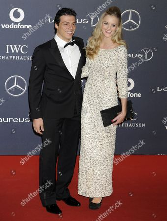 French-greek-algerian Inline Skater Taig Khris (l) and a Guest Arrive at the Laureus World Sports Awards in London Britain 06 Febuary 2012 the Laureus World Sports Awards Are Held Annually to Honour Sports People who Have Been Outstanding During the Previous Year United Kingdom London