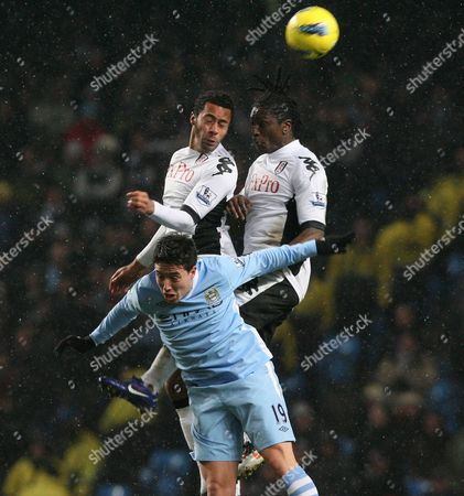 Stock Image of Manchester City's Samir Nasri (bottom) is Beaten by Fulham's Mousa Dembele (top Left) and Dickson Etuhu During Their English Premiership League Soccer Match at the Etihad Stadium in Manchester Britain 04 February 2012 Dataco Terms and Conditions Apply Http//www Epa Eu/downloads/dataco-tcs Pdf United Kingdom Manchester
