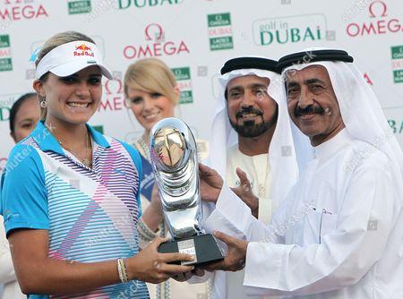Us Golfer Alexis Thompson (l) Receives Her Trophy From H H Sheikh Hasher Bin Maktoum Al Maktoum (r) Director General Dubai Department of Information After Winning the Final Round at Omega Dubai Ladies Masters in Dubai United Arab Emirates 17 December 2011 United Arab Emirates Dubai