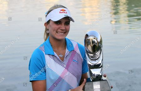 Us Golfer Alexis Thompson Holds Her Trophy After Winning the Final Round at Omega Dubai Ladies Masters in Dubai United Arab Emirates 17 December 2011 United Arab Emirates Dubai