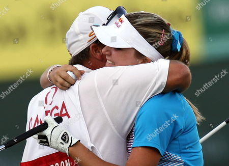 Us Golfer Alexis Thompson Hugs Her Father and Caddie As She Celebrates After Winning the Final Round at Omega Dubai Ladies Masters in Dubai United Arab Emirates 17 December 2011 United Arab Emirates Dubai