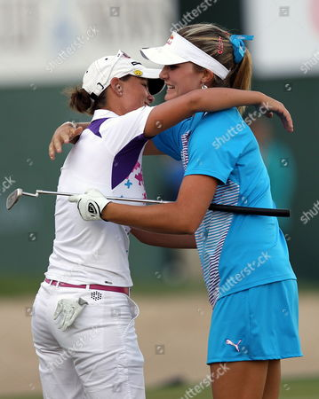 Us Golfer Alexis Thompson (r) Hugs the Second Placed Lee-anne Pace (l) of South Africa After Winning the Final Round at Omega Dubai Ladies Masters in Dubai United Arab Emirates 17 December 2011 United Arab Emirates Dubai