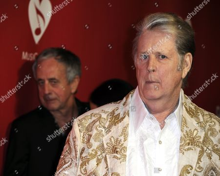 Us Singer Brian Wilson (r) Arrives For the 2012 Musicares Person of the Year Gala Honoring Paul Mccartney in Los Angeles California Usa 10 February 2012 Musicares Provides a Safety Net of Critical Assistance For Music People in Times of Need United States Los Angeles