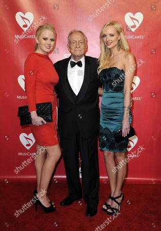 Us Publisher Hugh Hefner (c) with Us Actress Anna Berglund (l) and Canadian Actress Shera Bechard (r) Arrive For the 2012 Musicares Person of the Year Gala Honoring Paul Mccartney in Los Angeles California Usa 10 February 2012 Musicares Provides a Safety Net of Critical Assistance For Music People in Times of Need United States Los Angeles