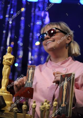 Stock Photo of Pastry Chef Sherry Yard Wears 3d Glasses As She Introduces Her Gold-dusted Chocolate Oscars at the 84th Academy Awards Governors Ball Food and Beverage Preview in Hollywood California Usa 16 February 2012 the Sweets Pay Homage to the Future of Oscar in 3d United States Hollywood