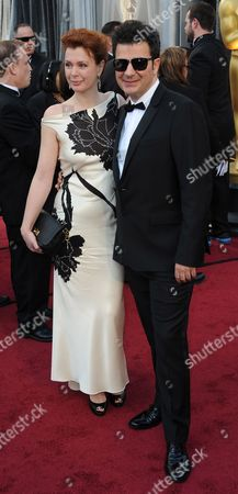 French Composer Ludovic Bource (r) and a Guest Arrive For the 84th Annual Academy Awards at the Hollywood and Highland Center in Hollywood California Usa 26 February 2012 the Oscars Are Presented For Outstanding Individual Or Collective Efforts in Up to 24 Categories in Filmmaking United States Hollywood