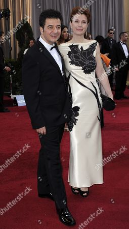 French Composer Ludovic Bource (l) and Guest Arrive For the 84th Annual Academy Awards at the Hollywood and Highland Center in Hollywood California Usa 26 February 2012 the Oscars Are Presented For Outstanding Individual Or Collective Efforts in Up to 24 Categories in Filmmaking United States Hollywood