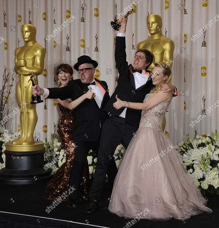 Stock Photo of William Joyce (2nd L) and Brandon Oldenburg (2nd R) Hold the Oscar For Best Animated Short Film For 'The Fantastic Flying Books of Mr Morris Lessmore' As They Stand with Us Actresses Wendi Mclendon-covey (r) and Ellie Kemper (l) During the 84th Annual Academy Awards at the Hollywood and Highland Center in Hollywood California Usa 26 February 2012 the Oscars Are Presented For Outstanding Individual Or Collective Efforts in Up to 24 Categories in Filmmaking United States Hollywood