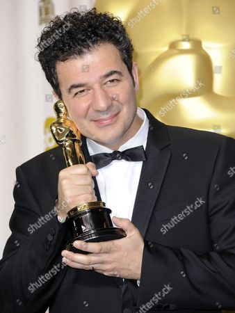 French Composer Ludovic Bource Holds His Oscar For Achievement in Music (original Score) For 'The Artist' During the 84th Annual Academy Awards at the Hollywood and Highland Center in Hollywood California Usa 26 February 2012 the Oscars Are Presented For Outstanding Individual Or Collective Efforts in Up to 24 Categories in Filmmaking United States Hollywood