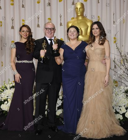 Stock Photo of Irish Filmmakers Terry (2nd L) and Oorlagh George (2nd R) Hold the Oscar For Best Live Action Short Film For 'The Shore' As They Stand with Presenters Kristen Wiig (r) and Maya Rudolph (l)during the 84th Annual Academy Awards at the Hollywood and Highland Center in Hollywood California Usa 26 February 2012 the Oscars Are Presented For Outstanding Individual Or Collective Efforts in Up to 24 Categories in Filmmaking United States Hollywood