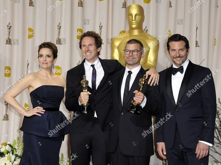 Us Actress and Presenter Tina Fey (l) and Us Actor and Presenter Bradley Cooper (r) Stand with Kirk Baxter (2nd L) and Angus Wall (2nd R) As They Hold the Oscar For Achievement in Film Editing For 'The Girl with the Dragon Tattoo' During the 84th Annual Academy Awards at the Hollywood and Highland Center in Hollywood California Usa 26 February 2012 the Oscars Are Presented For Outstanding Individual Or Collective Efforts in Up to 24 Categories in Filmmaking United States Hollywood