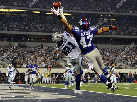 Dallas Cowboys Mike Jenkins (l) Blocks the Ball Against New York Giants Player Travis Beckum (r) in the End Zone in the First Half of the Game at Cowboys Stadium in Arlington Texas Usa 11 December 2011 United States Arlington