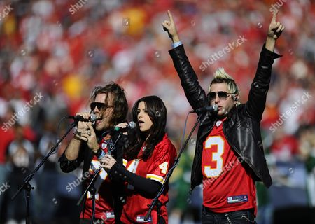 The Band Gloriana Featuring Tom Gossin (l) Rachel Reinet (c) and Mike Gossin (r) Sing the National Anthem Before the Start of the Denver Broncos Game Against the Kansas City Chiefs at Arrowhead Stadium in Kansas City Missouri Usa 13 November 2011 United States Kansas City