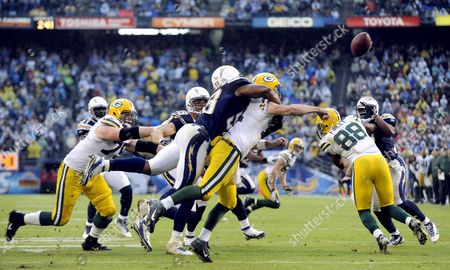 San Diego Chargers Linebacker Antwan Barnes (l) Puts Pressure on Green Bay Packers Quarterback Aaron Rogers (c) Forcing a Punt in the Fourth Quarter of Play in San Diego California Usa 06 November 2011 the Packers Beat the Chargers 45-38 United States San Diego