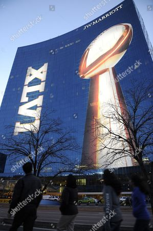 People Walk Past the Front of the J W Marriott Hotel where the Super Bowl Media Center is Located During the Week Leading Up to Super Bowl Xlvi in Indianapolis Indiana Usa 30 January 2012 Super Bowl Xlvi Will Be Played 05 February 2012 Between the New England Patriots and the New York Giants at Lucas Oil Stadium in Indianapolis Indiana Usa United States Indianapolis