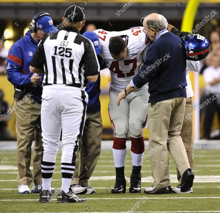 Stock Photo of New York Giants Tight End Travis Beckum is Carried Off the Field After Tearing His Acl in Lucas Oil Stadium During Super Bowl Xlvi Between the New England Patriots and the New York Giants in Indianapolis Indiana Usa 05 February 2012 the Super Bowl is Annual Championship of the National Football League United States Indianapolis