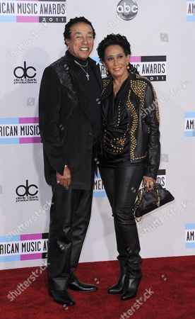 Us Singer/songwriter Smokey Robinson (l) Arrives with His Wife Frances Gladney (r) For the 39th American Music Awards Held at the Nokia Theatre in Los Angeles California Usa 20 November 2011 United States Los Angeles