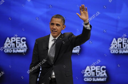 Us President Barack Obama Waves to Audience Before Participating in the Apec Leader Interaction with W James (jim) Mcnerney Jr Chairman President & Ceo the Boeing Company at the Asia-pacific Economic Cooperation Summit Usa Held at the Sheraton Waikiki Ballrooms in Honolulu Hawaii 12 November 2011 United States Honolulu