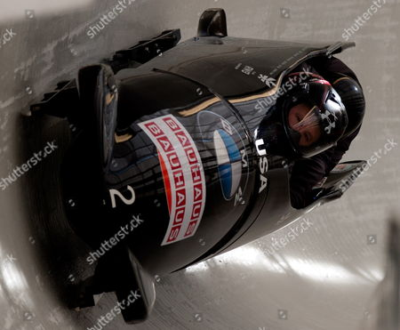 The United States Four Man Bobsleigh Lead by Current Olympic Gold Medal Winner Steve Holcomb Take a Curve During a Training Session For the Fibt Bobsleigh World Championships Held at Lake Placid New York Usa 21 February 2012 United States Lake Placid