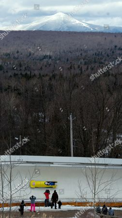 Thibault Alexis Godefroy and Alexandre Jolivet of France Exit Curve 18 As Whiteface Mountain is Seen in the Background During the Second Heat of the Fibt Bobsleigh World Championships Held at Lake Placid New York Usa 18 February 2012 United States Lake Placid
